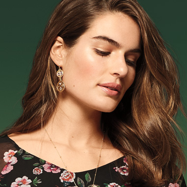 Don't leave your look to chance – toss on coin-inspired earrings for an elegant finishing look.